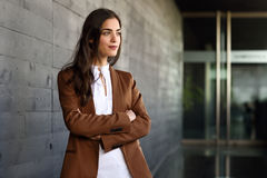 Young businesswoman standing outside of office building. Stock Image