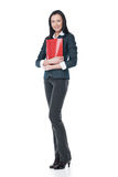 Young businesswoman standing with red folder. Royalty Free Stock Images