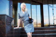 Young businesswoman on the steps. Royalty Free Stock Photography