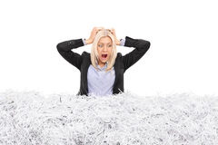 Young businesswoman stuck in a pile of shredded paper Stock Photography