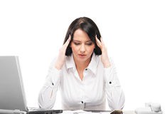 Young businesswoman suffering from a beadache in the office Royalty Free Stock Photo