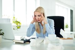 Young businesswoman suffering flu at work stock photography
