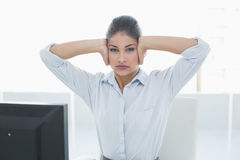 Young businesswoman suffering from headache in front of computer Stock Image