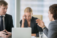 Young businesswoman suffering from headache royalty free stock photography