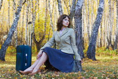 Young businesswoman with suitcase. Stock Images