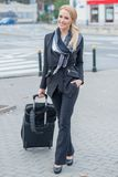 Young businesswoman with a suitcase Stock Image