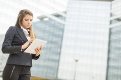 Young businesswoman with tablet Stock Photos