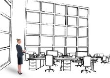 young businesswoman with tablet on office lines . Design of the new office Royalty Free Stock Photo