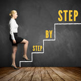 Young businesswoman taking the first step towards her goal Royalty Free Stock Photos