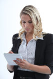 Young businesswoman taking notes Royalty Free Stock Photo