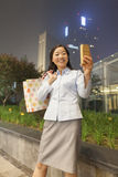 Young businesswoman taking a picture of her self with her Cell Phone Stock Image