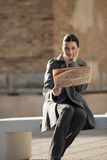 Young businesswoman taking a rest with newspaper Royalty Free Stock Photography