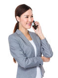 Young businesswoman talk mobile phone Royalty Free Stock Photos