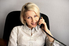 Young businesswoman talk on the phone Stock Photo