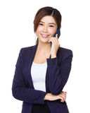 Young businesswoman talk to cellphone Royalty Free Stock Photos