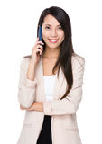 Young businesswoman talk to cellphone Stock Images