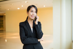 Young Businesswoman talk to cellphone at office Stock Images