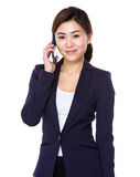 Young businesswoman talk to mobile phone Royalty Free Stock Photography
