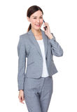 Young businesswoman talk to mobile phone Royalty Free Stock Image