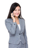 Young businesswoman talk to mobile phone Stock Photography