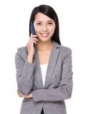 Young businesswoman talk to mobile phone Royalty Free Stock Photo