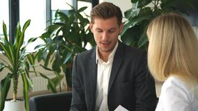 Young businesswoman talking with a colleague about the business plan. In office stock footage