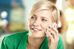 Young businesswoman talking on mobile Royalty Free Stock Photos
