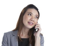 Young Businesswoman talking on mobile phone Royalty Free Stock Image
