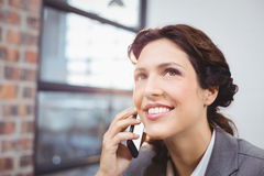 Young businesswoman talking on mobile phone Stock Photos