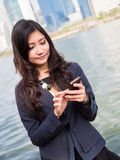 Young businesswoman talking on mobile phone Royalty Free Stock Photo
