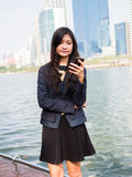 Young businesswoman talking on mobile phone Stock Image
