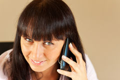 Young businesswoman talking over the phone Stock Photography