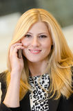 Young businesswoman talking on the phone Royalty Free Stock Photography