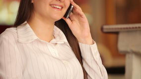 Young businesswoman talking on the phone stock footage