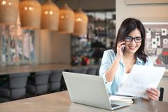 Young businesswoman talking on phone in coffee shop royalty free stock images