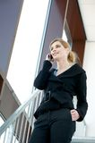 Young businesswoman talking on the phone indoors Stock Photos