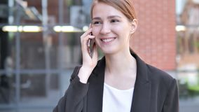 Young Businesswoman Talking on Phone Outdoor. 4k high quality, 4k high quality stock footage