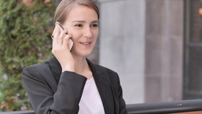 Young Businesswoman Talking on Phone Sitting Outdoor. 4k high quality, 4k high quality stock video