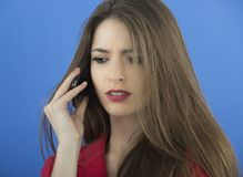 Young businesswoman talking on smart phone Stock Image