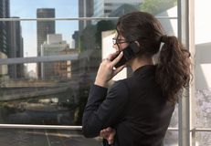 Young businesswoman talks on mobile Royalty Free Stock Photography