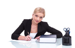 Young businesswoman or teacher working at her desk. Stock Photos