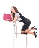 Young Businesswoman with telephone on chair. On a white background Royalty Free Stock Image