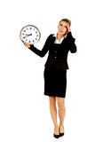 Young businesswoman terrified looks at the clock Royalty Free Stock Photography