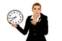 Young businesswoman terrified looks at the clock Stock Images