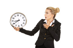 Young businesswoman terrified looks at the clock Stock Photography