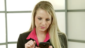 Young businesswoman texting Royalty Free Stock Image