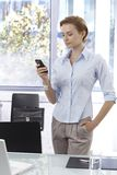Young businesswoman texting Royalty Free Stock Photo