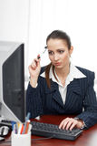 Young businesswoman thinking at desk Royalty Free Stock Photos