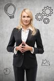 Young businesswoman thinking Stock Photo