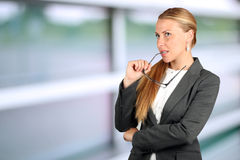 Young businesswoman thinking about an idea royalty free stock images
